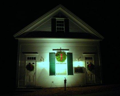 Westport Community Church at night with Christmas wreathes
