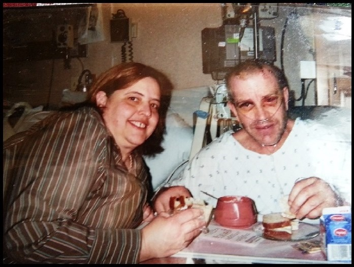 Paul in his hospital bed eating with his wife