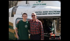 Paul and his son in fron of a Lifeflight helicopter
