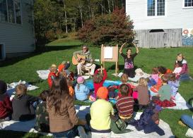 students with families at outside music class
