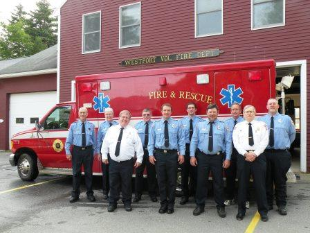 Westport Volunteer Fire Department in front of rescue vehicle