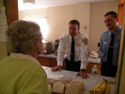 Firefighters Jason Abbott and James Richardson talking to Ruth Nelson at the Town Meeting
