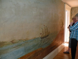 West hallway mural with three masted schooner headed to a lighthouse