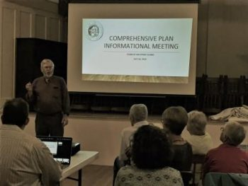 chair of the comprehensive planning committee introducing plan at public hearing